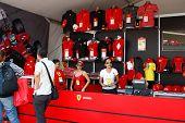 SEPANG, MALAYSIA - APRIL 8: Unidentified salesgirls from the Ferrari merchandise shop wait for custo