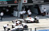 SEPANG, MALAYSIA - APRIL 8: Mexican Sergio Perez of the Sauber F1 Team returns to a busy pit on the