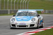 SEPANG - JUNE 17: Christian Chia in a Porsche 997 Cup 3.8 takes to the tracks of the Sepang Internat