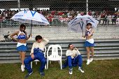 SEPANG - JUNE 19: Team Impul's drivers Tsugio Matsuda and Joao Paulo Lima de Oliveira waits for the