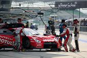 SEPANG, MALAYSIA - JUNE 19: NISMO's mechanics work on the team's Nissan GT-R R35 car during a practi