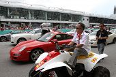 SEPANG, MALAYSIA - JUNE 19: Luxury cars and sports cars line up the race track on display during the