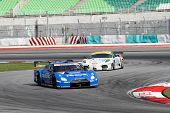 SEPANG, MALAYSIA - JUNE 19: The Nissan GTR R35 car of Team IMPUL accelerates into turn 2 of the Sepa