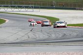 SEPANG, MALAYSIA - JUNE 18: Race cars put in some practice laps at the Sepang International Circuit
