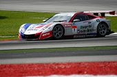 SEPANG, MALAYSIA - JUNE 18: The race car of Weider Honda Racing team puts in some practice laps in t