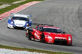 SEPANG, MALAYSIA - JUNE 18: The Nissan GTR car of NISMO team puts in some practice laps in the Sepan