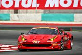 SEPANG, MALAYSIA - JUNE 18: The Ferrari 458 car of Jimgainer puts in some practice laps in the Sepan