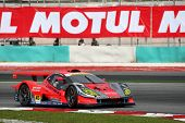 SEPANG - JUNE 18: The Arta Garaiya car of Autobacs Racing Team Aguri puts in some practice laps in t