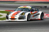 SEPANG, MALAYSIA - JUNE 18: The Porsche 911 car of Hankook KTR puts in some practice laps in the Sep