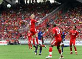 BUKIT JALIL- JULY 16: Liverpool's Dirk Kuyt heads the wall watched by David Ngog (24) in their game