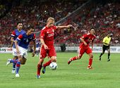 BUKIT JALIL, MALAYSIA - JULY 16: Liverpool's Dirk Kuyt tries a shot at goal against Malaysia in this