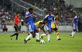 BUKIT JALIL, MALAYSIA - JULY 21: Chelsea's Didier Drogba (front, in blue) kicks the ball in a game a