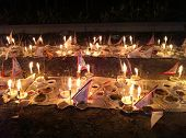 PUCHONG, MALAYSIA - AUGUST 27: Prayer offerings for the ancestors, consisting of joss-sticks, candle