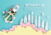 Paper Art Style Of Rocket Breaking Through Paper Over Modern City, Start Up Business Concept, Flat-s poster
