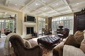 picture of ottoman  - Large family room with fireplace and wall of windows - JPG