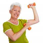 Senior Woman Showing Off Her Muscles