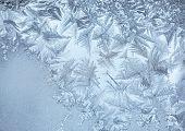 Frost pattern on window glass, closeup poster
