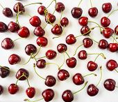 Fresh Red Cherries Lay On White Isolated Background With Copy Space. Background Of Cherries. Ripe Ch poster