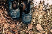 Old Burnt Shoes On The Burnt Grass. poster