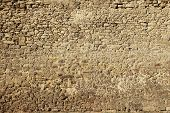 The Texture Of The Ancient Ancient Wall Of The Fortress Made Of Stone Illuminated By The Sun poster