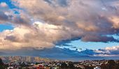 Amazing Dramatic Cloudy Sunrise Over The City And Beautiful Dramatic Sky With Clouds In Small Bay. C poster