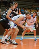 KAPOSVAR, HUNGARY - SEPTEMBER 8: Bence Biro (in white C) in action at a friendly basketball game between Kaposvar (white) and Pecsi VSK (black) September 8, 2011 in Kaposvar, Hungary.