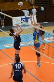 KAPOSVAR, HUNGARY - APRIL 24: Zsofia Harmath (R) in action at the Hungarian NB I. League woman volle