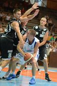 KAPOSVAR, HUNGARY - SEPTEMBER 8: Nik Raivio (white 5) in action at a friendly basketball game between Kaposvar (white) and Pecsi VSK (black) September 8, 2011 in Kaposvar, Hungary.