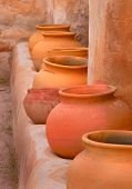 Pots And Adobe Wall