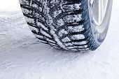 The Car Tire In The Snow Close Up. Car Tracks On The Snow. Traces Of The Car In The Snow. Winter Tir poster