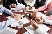 stock photo of business meetings  - Image of different hands at business meeting - JPG