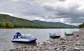 stock photo of airboat  - Modern boats on the river bank - JPG