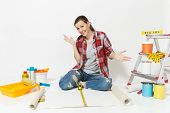 Woman Sitting On Floor With Wallpaper Rolls, Measure Tape, Instruments For Renovation Apartment Isol poster
