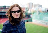 Young Woman In Sunglasses Visiting A Baseball Park