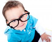 Funny boy wearing big glasses - isolated over a white background