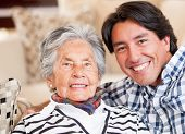 foto of grandmother  - Happy portrait of a grandmother and her grandson smiling - JPG