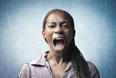 stock photo of angry  - Angry young african woman screaming - JPG
