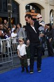 LOS ANGELES - JAN 23: Gavin Rossdale with sons Kingston and Zuma at the premiere of 'Gnomeo & Juliet