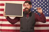 Becoming A Master Barber. Barber Teaching Barbering On American Flag Background. Bearded Barber Hold poster
