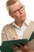 Perplexed Woman With Pencil And Folder