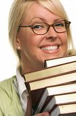 Cute Student Rests Her Chin On Stack Of Books