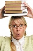 Astonished Woman With Stack Of Books