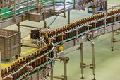 Beer Production. Beverage Bottling Line. Plastic Bottles In The Factory. Conveyor Beer Bottles. poster
