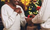 Christmas Proposal. Unrecognizable African American Man Giving Engagement Ring To His Excited Girlfr poster