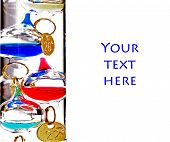 Close up of Galileo Thermometer on white with space for text