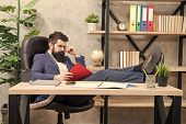 Owner Of Small Business. Man Bearded Businessman Sit Office Read Business Report. Analyzing Financia poster