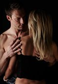 stock photo of breast-stroke  - Young and fit caucasian adult couple in an embrace - JPG