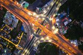 Aerial View Of Highway Junctions Top View Of Urban City, Bangkok At Night, Thailand. Light Trails Ac poster