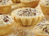picture of confectioners  - Sweet pecan tarts with a light sprinkle of confectioner - JPG