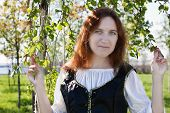 image of shepherdess  - Young medieval woman standing near the birch - JPG
